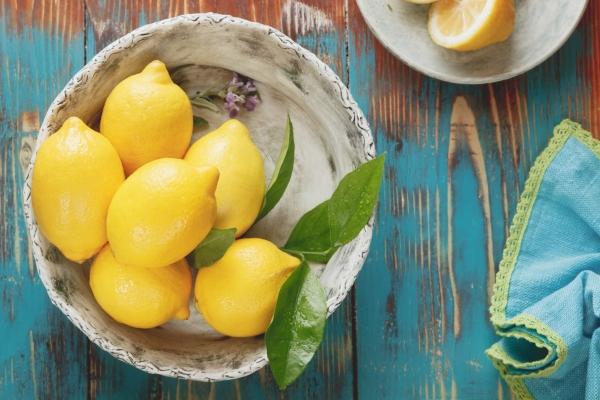 Bowl of Lemons on Table